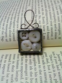 Antique Baby Buttons Shadowbox Soldered Glass Pendant via Etsy