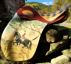 The other side this retired Stübben saddle hand-painted by Lisa Curry Mair of Canvasworkds Designs.