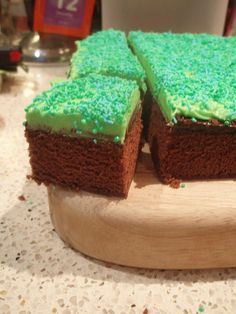 Chocolate cake, green icing and green sprinkles! Minecraft themed! Also marble cake with white icing and red squares on top for another block cake.