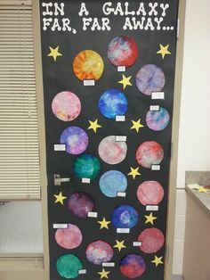 Objects in the sky unit-colored coffee filters, sprayed with water, children named their planets and then told me characteristics about their planets