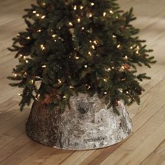 After spending hours decorating the perfect tree, it would be a shame not to finish. Our handsome Birch Tree Collar is a rustic alternative to the traditional Christmas tree skirt. The collar is handmade from sheets of natural birch bark and fits neatly around the base of your tree to conceal that not-so-pretty screw-on stand.  Birch Tree Collar features:  Perfect for rustic & modern farmhouse decor. Fits our 7.5-foot tree. Handmade of birch bark. Wire frame.