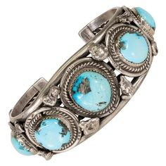 """Navajo Kingman turquoise bracelet with five nuggets surrounded by twisted rope border. Turquoise is stunning lighter blue color of excellent quality. PERIOD: After 1950 ORIGIN: Navajo, Southwest SIZE: 7"""", 1 3/4"""" Opening, 1 1/4""""H Kingman Mine, Turquoise, Sterling Silver, Bracelets, Navajo Golden Jewelry, Silver Jewelry, Navajo Jewelry, Silver Cuff, Sterling Silver, Silver Rings, Vintage Turquoise Jewelry, Turquoise Bracelet, Vintage Jewelry"""