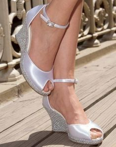 this wedge has a bit of a vintage feel with the peep toe& but they didn& forget the bling. this wedge has a bit of a vintage feel with the peep toe& but they didn& forget the bling. Bridal Wedges, Wedding Wedges, Wedge Wedding Shoes, Bridal Wedding Shoes, Wedge Shoes, Shoes Heels, Wedding Veils, Wedge Sandals, Dress Shoes