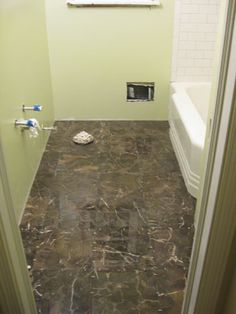 Tackling The Bathroom: Chapter Five - has links to all the previous posts so you can see it from start to finish! John and Sherry rock!
