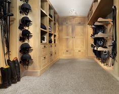 tack room - love the racks for saddles & helmets & all the drawers & closet at the end