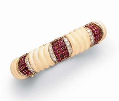 **AN IVORY, RUBY AND DIAMOND BANGLE BRACELET, BY VAN CLEEF & ARPELS