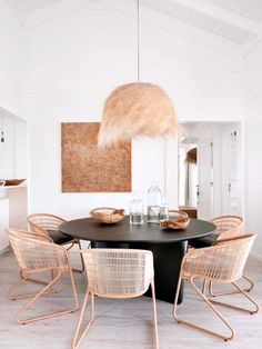 grass lampshade over black dining table with rattan chairs. / sfgirlbybay