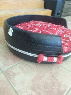 I made this dog bed from a car tire.