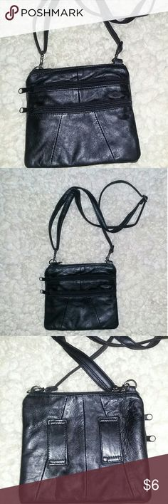 Black leather purse Cute black leather purse. Been sitting I'm my closet forever and decided it needed a better home. As you can see in pics #6 and 7 there are small marks but nothing too serious.  The size of the purse is about 7 inches across and 6 inches going down. Bags Mini Bags