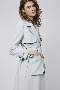 Tailored detailing comes updated for the season in this bonded truster trench coat. Crafted in a rich polyester blend, it features classic trench tailoring and a bonded belted waist to cinch and flatter. #Topshop