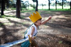 Stock Photo : Little boy with crown running in forest with sword