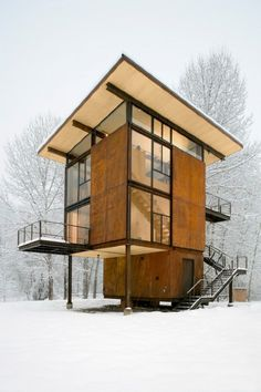 i like the porches without stilts and the windows geometry and roof metal stairs wood and snow