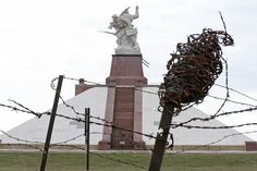 WWI barbed wire is seen near the Navarin monument, a pyramid inaugurated at Sommepy-Tahure in 1924 to pay tribute to World War I soldiers killed in Champagne, eastern France. (Charles Platiau/Reuters)