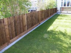 To prevent digging along the fence. Wood fence paver border.
