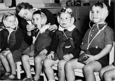 1942. Sydney. Australian children with antibomb hats.