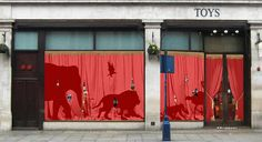 Hoarding design by Madeleine Sargent featuring a full circus apparently tramping past a red curtain (in the shop window) for Hamleys. This a lovely idea and would really engage children I think. It's fun because the animals are hidden but we we can see their silhouettes, so it would draw people in to see what was going on inside. Maybe keeping some elements 'hidden' will increase more suspense and excitement for the uncovering of the redevelopment.