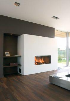 Moderne inbouw houthaard in modern interieur. Houthaard Luna van M-Design past in elk modern interieur. Luna 1150H heeft een vermogen van 10-12 KW. De houthaard heeft een gewicht van 270 kilogram.