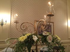 Candle-lit and flowery centerpiece