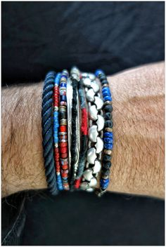 Ra's bracelets on his wrist. The thick silver bracelet came from Just Jewelry, the thin silver raven bracelet from the Silver Mine in Chemainus, the navy cord from Mauii and the thread bracelets Ra made himself.