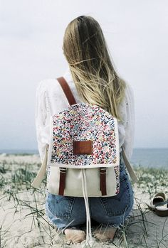 I want a new backpack so badly... love the leather and fabric applique on this one!