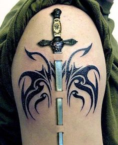 I would call this tattoo as 3 D tattoo. It is perfectly done, so we have the impression that sword actually passes through the skin really.
