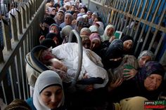 This is how our mothers and sisters daily suffering in The Israeli checkpoints and border crossings