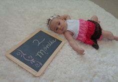 Baby month by month pictures with a chalkboard!