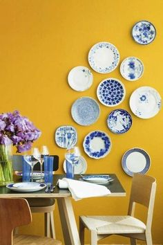 Great color combo: blue plates on yellow wall.