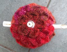 Crocodile stitch tea cosy                          To fit a small pot; larger size in brackets.        8 ply yarn ...