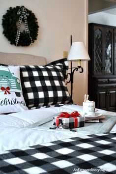 Warm up with the homemade touches of simple pillow shams and a throw like in this buffalo check Christmas bedroom Winter Bedroom Decor, Guest Room Decor, Guest Rooms, Christmas Interiors, Christmas Bedroom, Simple Christmas, Christmas Time, Plaid Christmas, Christmas Projects