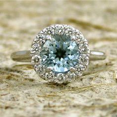 a different center stone  14k White Gold Aquamarine Diamond.