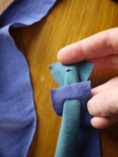 easy way to tie two pieces of fabric together without the obnoxious knot. two slits is all you need...
