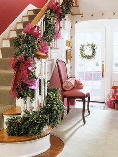 Natural Seasoning        Natural greens accented with oversize dark pink bows set the seasonal theme for this entryway.