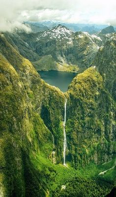 Sutherland Falls cascades down the green mountainside of New Zealand.