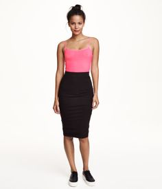 $12.99 Knee-length fitted skirt in jersey with elasticized waistband.
