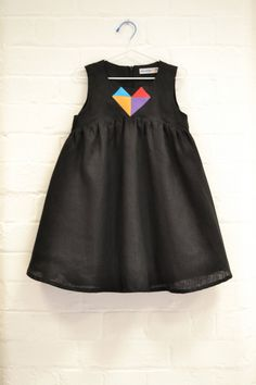 a black dress with a heart logo in the middle is so adorable!!