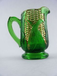 Vintage Corn on Cob Emerald Green Glass Creamer:  This classic Early American Pattern Glass was made by Challinor & Taylor of Tarentum, Pennsylvania in approximately 1898.  This charming little creamer was designed to look like an ear of freshly shucked corn!  The bright gold kernels absolutely jump out from the brilliant emerald green background.  Even the silk is represented in this gorgeous piece!