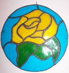 """""""ABC Products"""" - Stained Glass - Hanging Suncatcher (Yellow Rose). by dist e & h company. $10.97. Hanging ring soldered on the top. Round Stained glass hanging yellow rose. Can be hung anywhere you desire, inside or outside. Made from solder and cut stained glass. 5-3/4 inches in diameter. Made from solder and cut stained glass ~~ Round Stained glass hanging yellow rose ~~ Can be hung anywhere you desire, inside or outside ~~ Hanging ring soldered on the top  ..."""