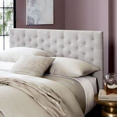 There's something so inviting about an upholstered headboard — and particularly a tufted headboard, which combines the coziness of an upholstered headboard with a touch of old-world glamour. If you'd like to add a bit of luxury to your bedroom, check out this roundup of 11 beautiful headboards for any budget: Modern Chesterfield Headboard at West Elm