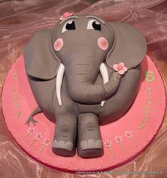 Elephant Cake. Elephant shaped cake finished with daisy flowers on a pink board