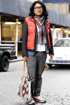 NYC by Monsieur Jerome. Hyundong (29 - Sales executive) wears Scarf by Drakes, Three Jackets by Rugby, Belstaff and vintage, Pants by Uniqlo, Shoes by Puma, Gloves by Louis Quatorce and vintage Bag.