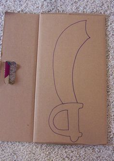Pirate Week Day Cardboard Sword Tutorial - Create in the .- Pirate Week Day Cardboard Sword Tutorial – Create in the Chaos cardboard-box-creations - Diy Pirate Costume For Kids, Homemade Pirate Costumes, Pirate Crafts, Pirate Halloween, Pirate Day, Pirate Birthday, Pirate Theme, Diy Halloween Costumes, Cardboard Sword