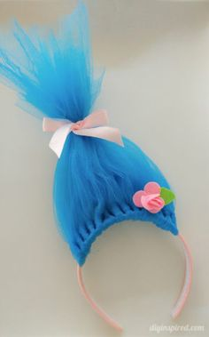 For softball opening day, the teams get dressed up in costumes. We are the Trolls so, I had to figure out how to make DIY Troll hair headbands.