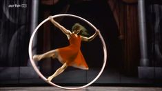 Angelica Bongiovonni - Beautiful Cyr Wheel Dance. For me, the performance I love starts at :50.)