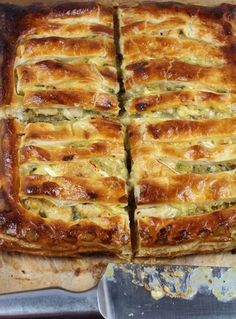 """Chicken, Leek Brie Pie (recipe) - """"Leeks cooked to a sweet caramelized state are mixed with chunks of juicy chicken pieces, swimming in a pool of white wine and salty stock. Topped with slices of creamy centered Brie cheese that melts into a gooey mess. Pastry Recipes, Pie Recipes, Cooking Recipes, Quiche Recipes, Dinner Recipes, Cooking Bacon, Savoury Recipes, Brunch Recipes, Brie"""