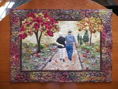Creator wrote,This quilt is a portrait of my parents. I made this for their 50th anniversary.