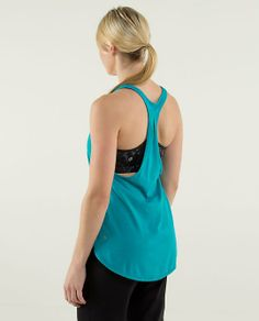 We designed this lightweight and loose-fitting tank to layer easily over any bra | 105 F Singlet *Silver