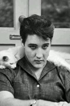 Elvis Presley and his white cat.