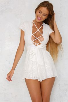 The oh so sweet Passionate Embrace Romper has a deep, v-neckline with a lattice feature across the bust. There is a cute lace sleeve and self tie waist detail, as well as invisible zip. Style back with a tan lace up sandal or a nude pump for the night!  Romper. Partially lined. Cold hand wash only. Model is a standard XS and is wearing XS. True to size. Lace placement may vary. Non stretchy fabric. Polyester.