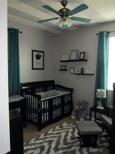 Grey chevron and teal or turquoise boys' nursery or room with black furniture. Painted ceiling fan.